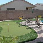 Smaller pool side practice putting green.